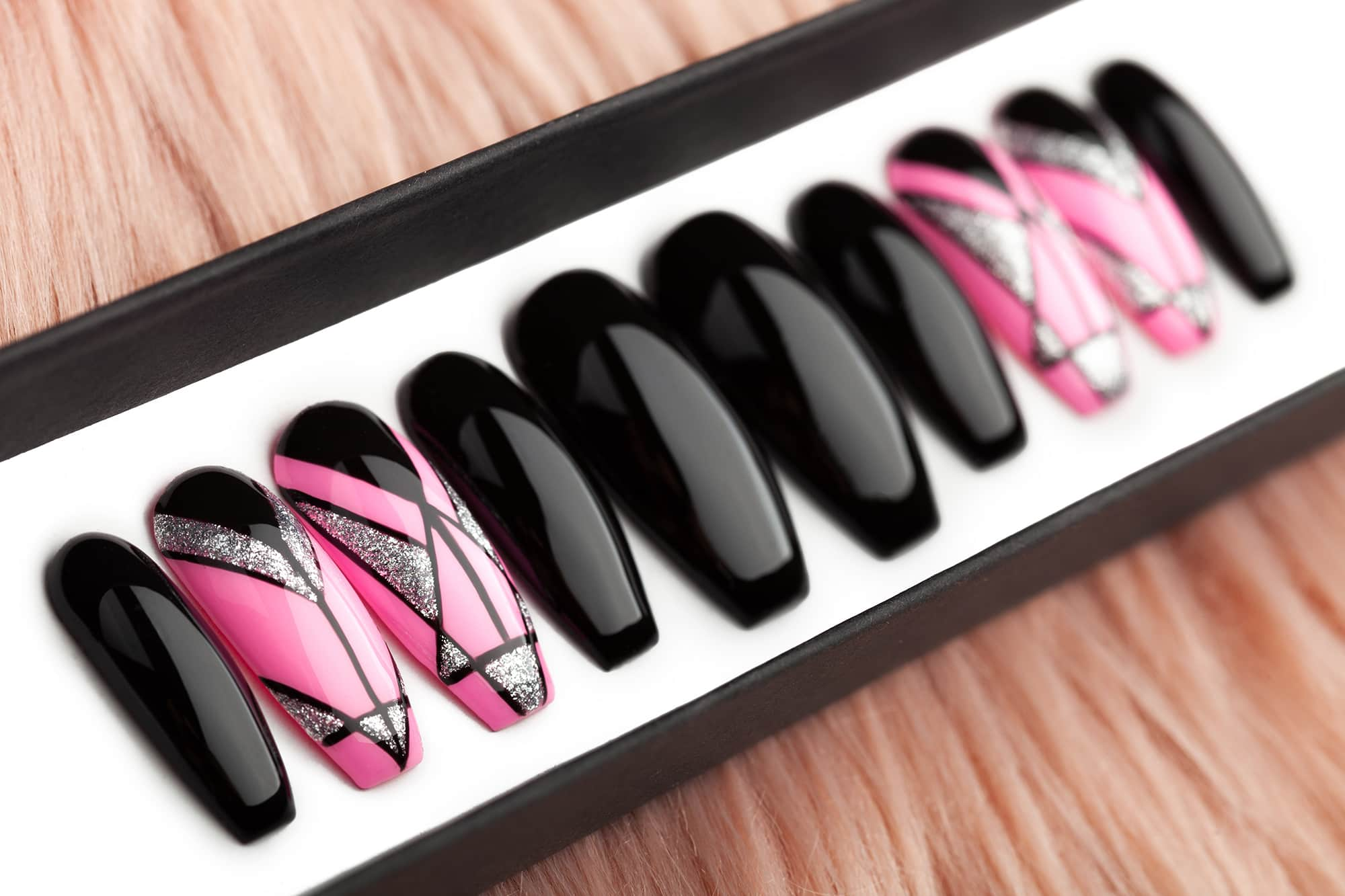 Glossy black press on nails with pink accent nails and geometry design