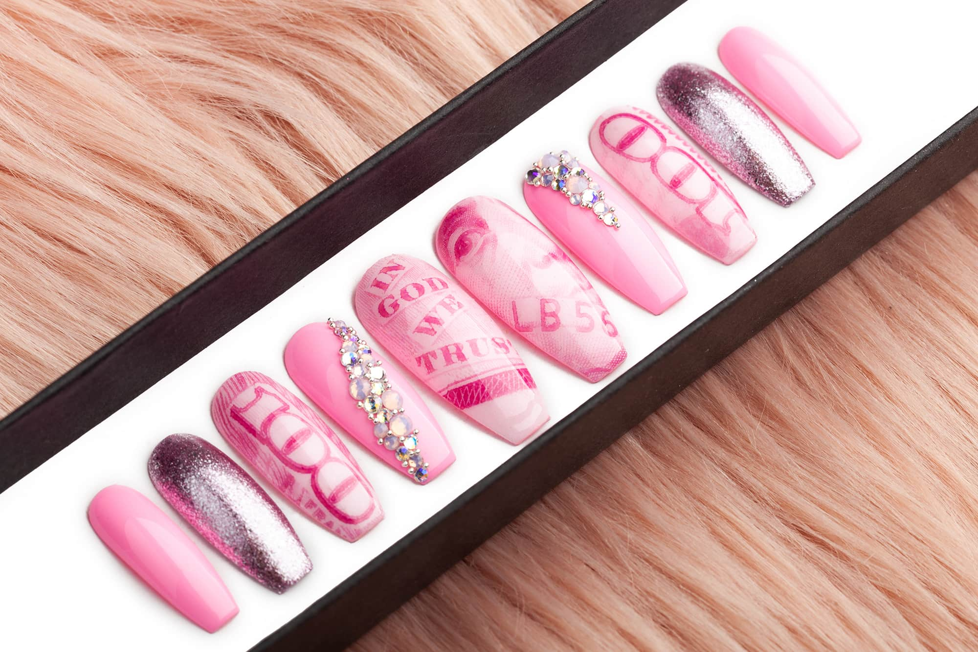 Pink version of Kylie nails with Swarovski crystals and dollars