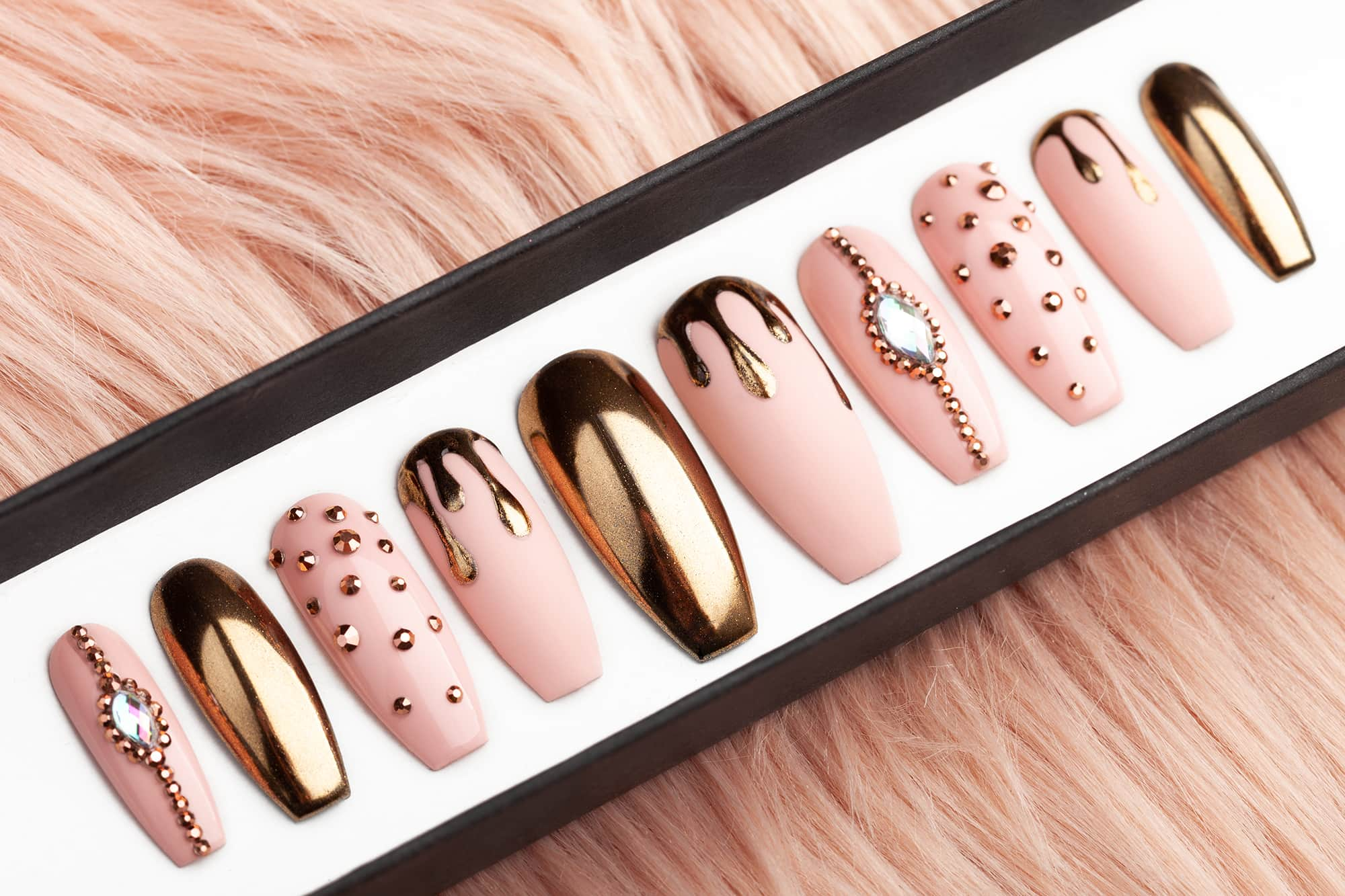 Rose gold press on nails with drips and Swarovski rhinestones