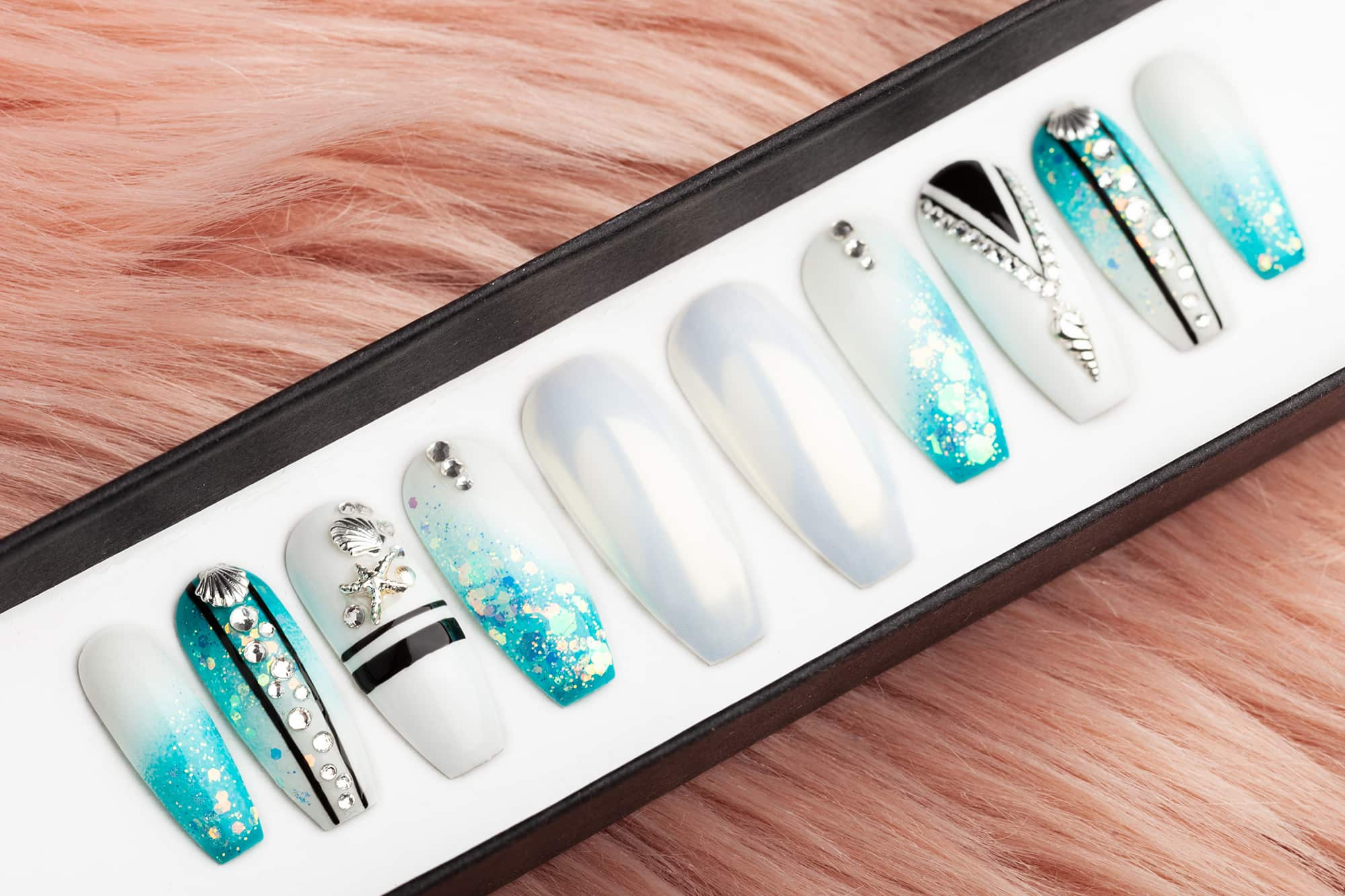 Luxury summer nails in pacific blue color