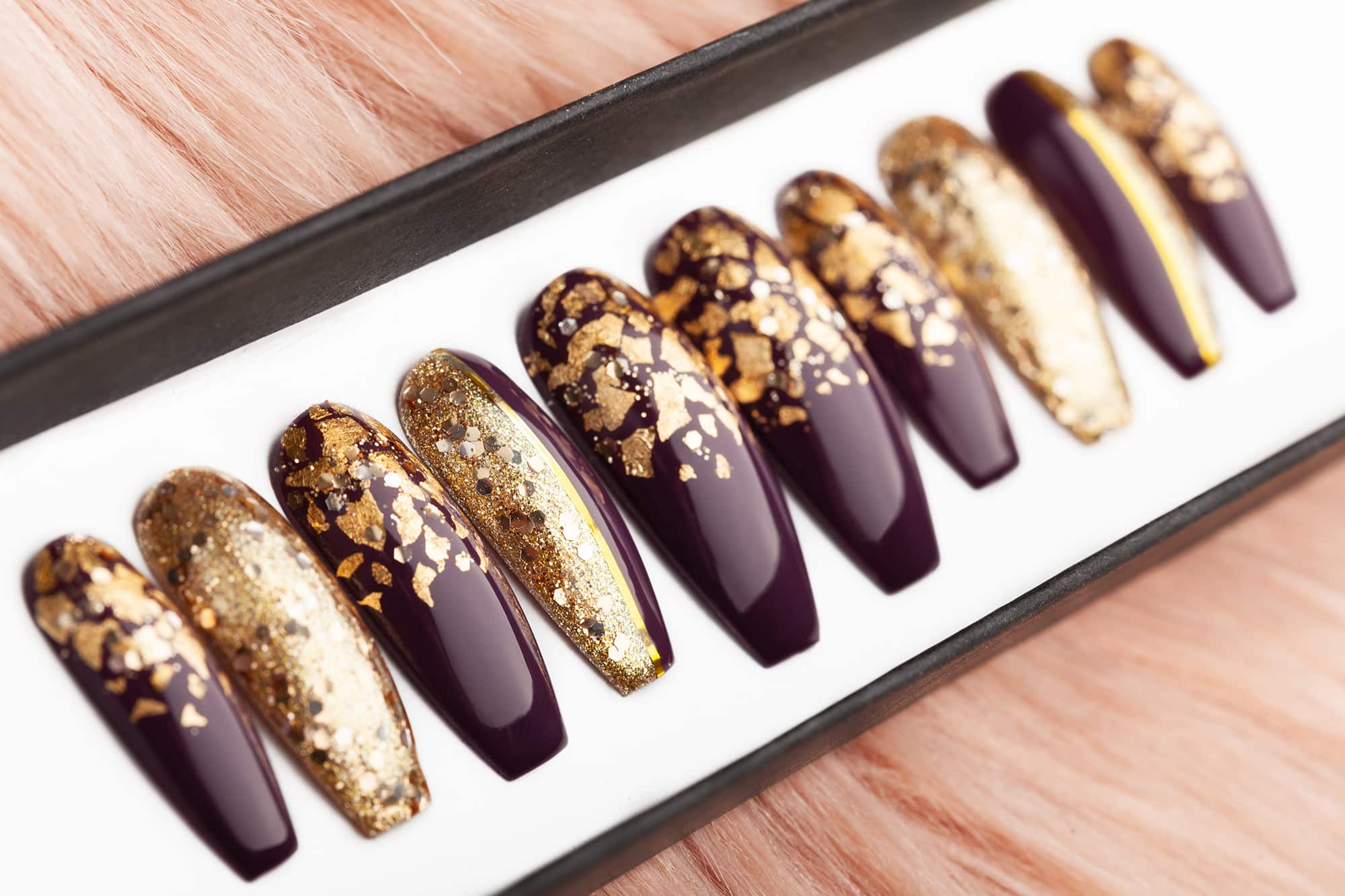 purple nails with golden flakes